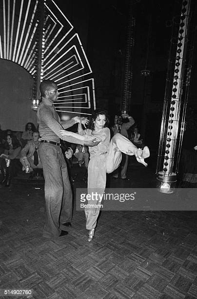 Bianca Jagger does some high stepping as she dances with actormodel Sterling St Jacques at a New York discotheque recently She is the wife of rock...