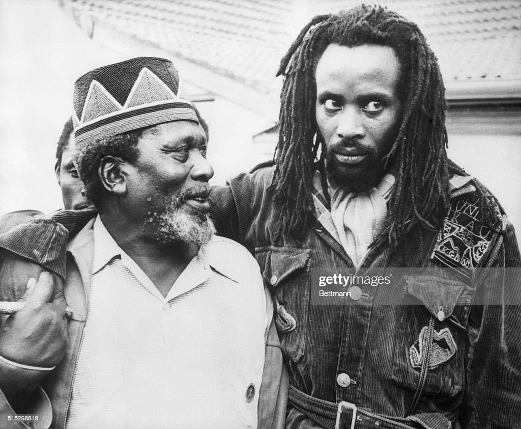 Nairobi, Kenya- Prime Minister <a gi-track='captionPersonalityLinkClicked' href=/galleries/search?phrase=Jomo+Kenyatta&family=editorial&specificpeople=211508 ng-click='$event.stopPropagation()'>Jomo Kenyatta</a> (once leader of the Mau Mau rebel movement) with 'Field Marshal' Mwariama, a Mau Mau leader who came to Kenyatta's home with a group of followers after the Prime Minister had promised amnesty to all rebels who left hiding by December 16th. Mwariama has undertaken that he and his substatial body of followers will surrender and leave their forest hiding places now that the colony is about to become independent.