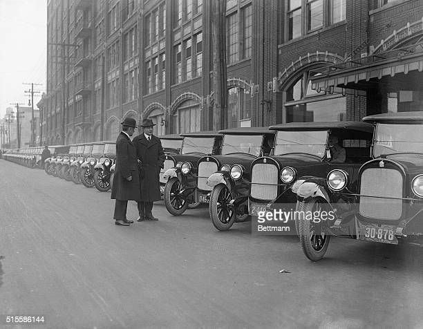 12/1/1921Long Island City NY William C Durant maker of Durant cars and William C Poertner inspect some of the 50 cars that were turned outof the...