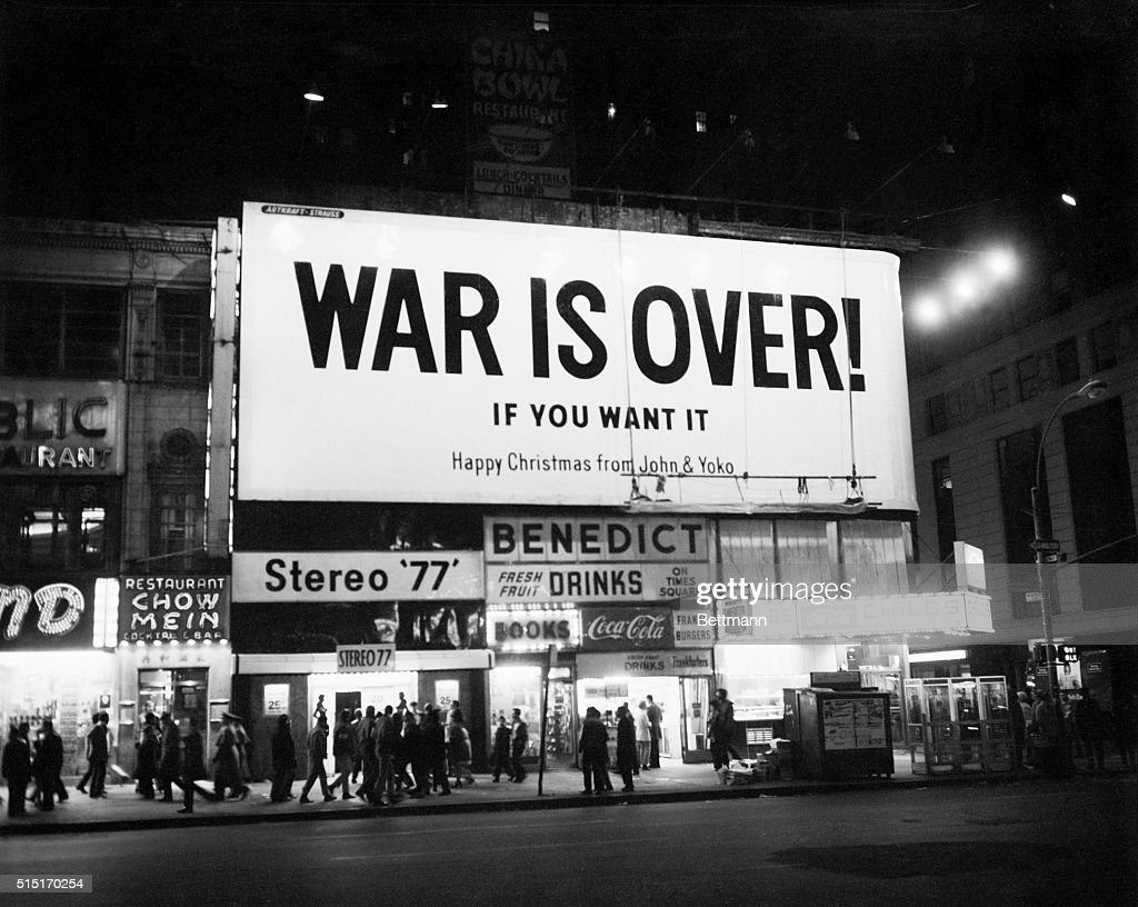 New York, NY- Sign on Times Square reads 'War is Over... If you want it. Happy Christmas from John and Yoko.' The sign was one of several large billboards purchased in 11 major world cities to display the Lennon's Christmas message for peace.