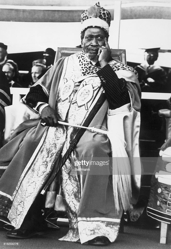Nairobi, Kenya- Wearing the gold and scarlet robe and leopard cap marking his installation as Chancellor of the University of Nairobi, Kenyan President <a gi-track='captionPersonalityLinkClicked' href=/galleries/search?phrase=Jomo+Kenyatta&family=editorial&specificpeople=211508 ng-click='$event.stopPropagation()'>Jomo Kenyatta</a> sits pensively atop the ceremonial platform. President Obote of Uganda was among attending faculty and officials.
