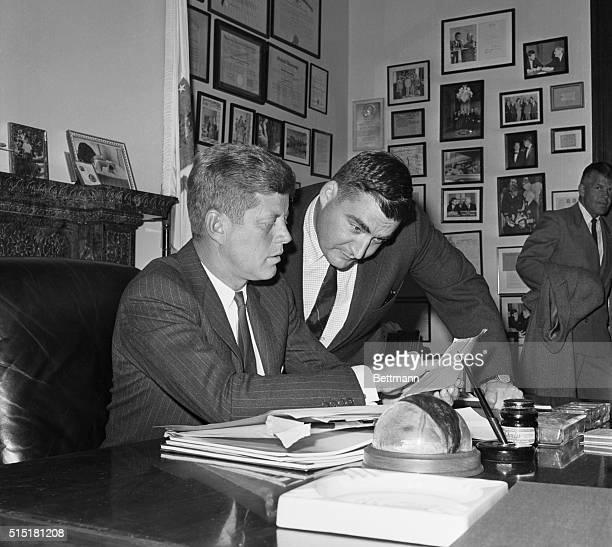 12/1/60Washington DC Back to work after a visit to wife and infant son at he hospital presidentelect Kennedy confers with Press Secretary Pierre...