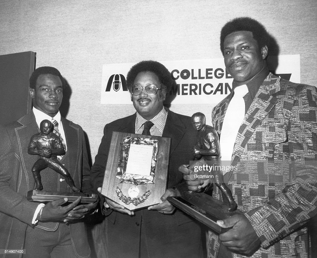 New York, New York- Winners of second annual Black College All-American Football Team Awards display trophies following presentation ceremonies. From left are: Jackson State Univ. (MS) running back, <a gi-track='captionPersonalityLinkClicked' href=/galleries/search?phrase=Walter+Payton&family=editorial&specificpeople=216517 ng-click='$event.stopPropagation()'>Walter Payton</a>, voted Offensive Player of the Year; head coach Marino Casem of Alcorn State Univ. (Lorman, MS), named Coach of the Year; and Outstanding Defensive Player of the Year, Gary Johnson of Grambling State University (Grambling, LA).