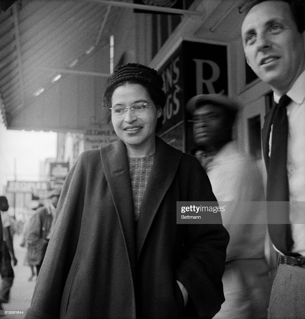 Montgomery, AL- Mrs. Rosa Parks, 43, is shown smiling as she walks on the street here, December 21. A Supreme Court ruling, which banned segregation on the city's public transit vehicles, took effect. Mrs. Parks' arrest on December 1st, 1955, for sitting in a bus forward of white passengers, touched off the boycott of Montgomery negroes against the city's bus lines.