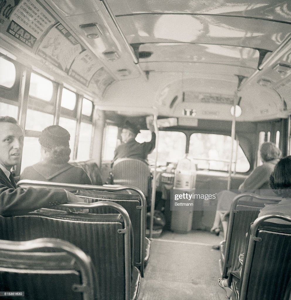 Montgomery, AL- Mrs. Rosa Parks, 43, sits in the front of a city bus here, December 21, as a Supreme Court ruling, which banned segregation on the city's public transit vehicles took effect. Mrs. Parks' arrest on December 1st, 1955, for sitting in a bus forward of white passengers, touched off the boycott of Montgomery negroes against the city's bus lines.