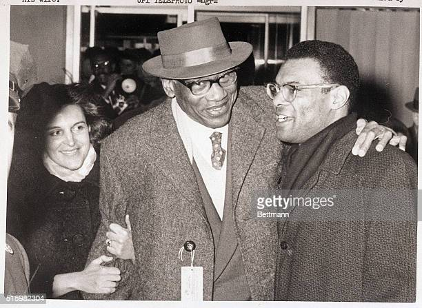 New York NY American Paul Robeson is greeted warmly by his son Paul Jr and the latter's wife Marilyn upon arrival in New York December 22nd It is the...