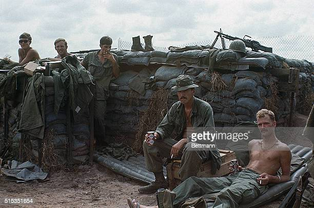 Cu Chi South Vietnam Troops of the mechanized units of the 25th Infantry Division take a break during a Christmas cease fire 12/25 at Fire Base Evans...