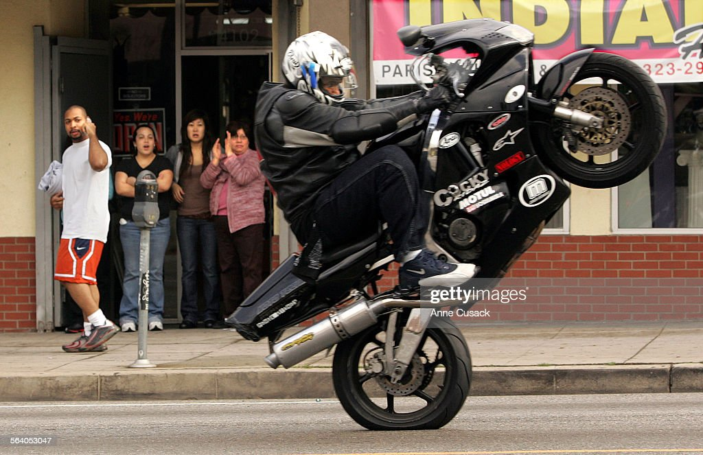 Los Angeles Motorcycles and cars performed stunts during the parade much to the delight of those who watched A parade celebrating Kwanza made it's...