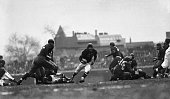 Chicago IL Sid Luckman of the Chicago Bears whose passtossing and work at quarter back made the star of the game romps through a big hole for a...