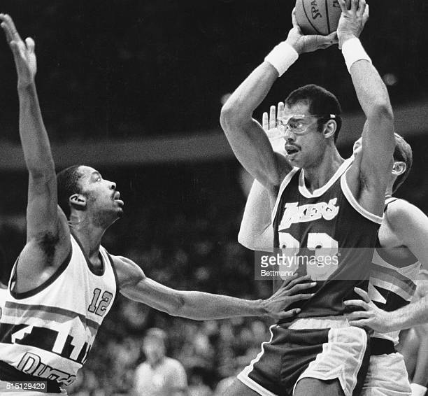 Denver CO Nuggets' Lafayette Lever pushes Lakers' Kareem AbdulJabbar into Nuggets' Dan Issel while trying to block AbdulJabbar's pass during first...