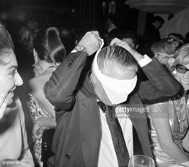 Paris France At the opening of a new play 'Pourquoi Pas' millionaire Aristotle Onassis perhaps felt the multitude of miniskirts were just too much...