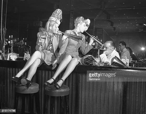 New York NY Betty Carson and Jean Hogan try hard but cannot seem to cheer up Jerry Therrien bartender at the Copacobana The rooting and tooting is...