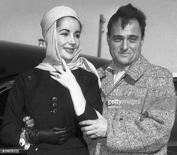 1/23/1957New YorkNYActress Elizabeth Taylor producer Mike Todd prepare to emplane at Idlewild Airport for Mexico CityThe couple told reporters there...