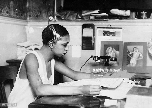 Photo shows Josephine Baker the dark star ofthe Follies Bergere as directrice of her own bar or cabaret She seems to be 'all business'