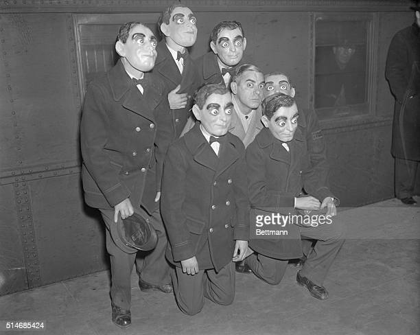 Telegraph messenger boys wearing Eddie Cantor masks were at the station to meet the movie and radio comedian when he arrived at Grand Central Station...