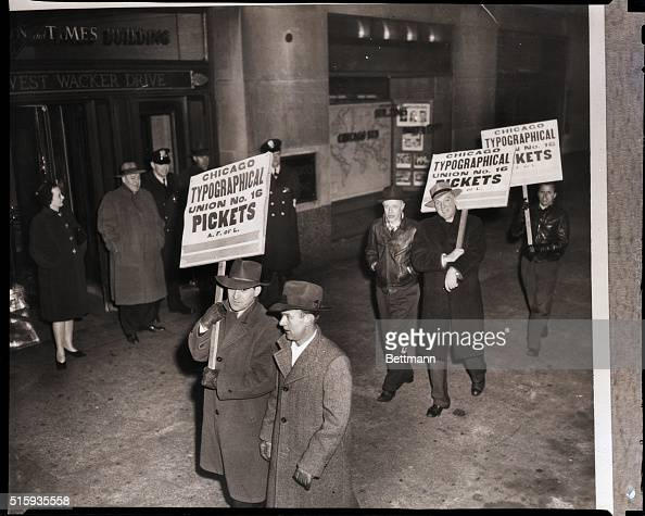 1/24/1947Chicago ILMembers of the Chicago Typographical Union picket the Chicago Sun and Times building after voting to walk out on Chicago's six...