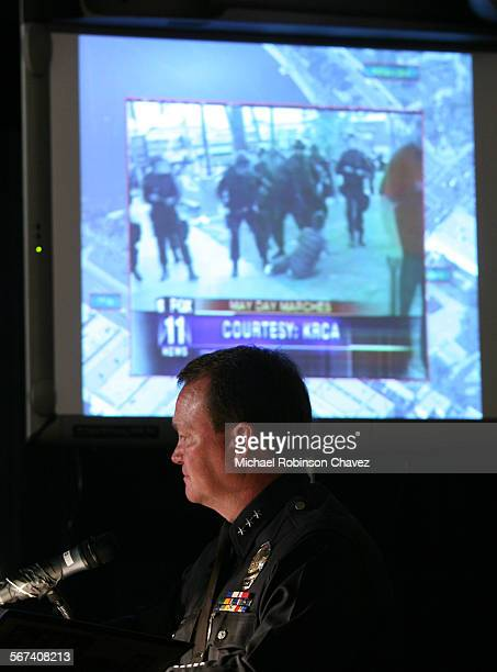 BrattonMRC LAPD Assistant Chief Jim McDonnell framed by a scene of LAPD in MacArthur Park gives the powerpoint presentation of the may 1 incidentThe...