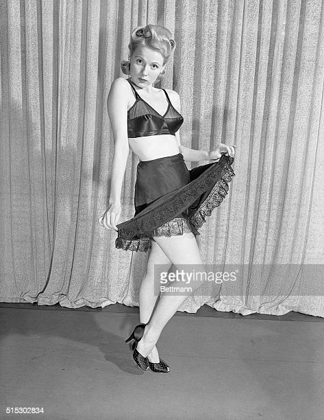 1/25/1942Even the most glamorous of legs are enhanced by whatchumaycallems like these Our blonde model raises the hem of her short petticoat to show...