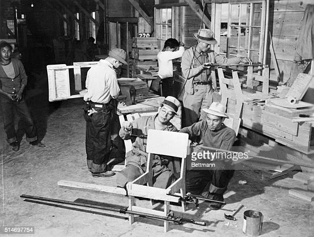 Furniture for schools public buildings and administrative offices is being made in the wood working shop by these Jap evacuee residents at the heart...