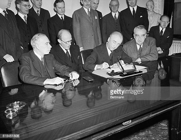 12/6/1945Washington DCIn a ceremony at the Department of State the British Loan Agreement was formally signed Pictured during the signing are left to...