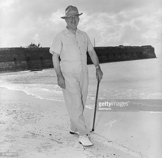 12/6/47West Key Florida Wearing an old hat and a sport shirt with the tails worn outside his pants President Truman takes a stroll along the beach at...