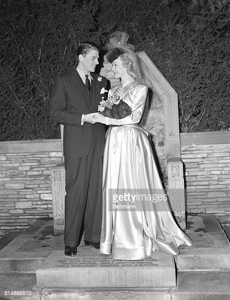 1/27/1940Glendale CA Jane Wyman and Ronald Reagan young film stars standing in front of the traditional 'Wishing Chair' at the Wee Kirk O'Heather...
