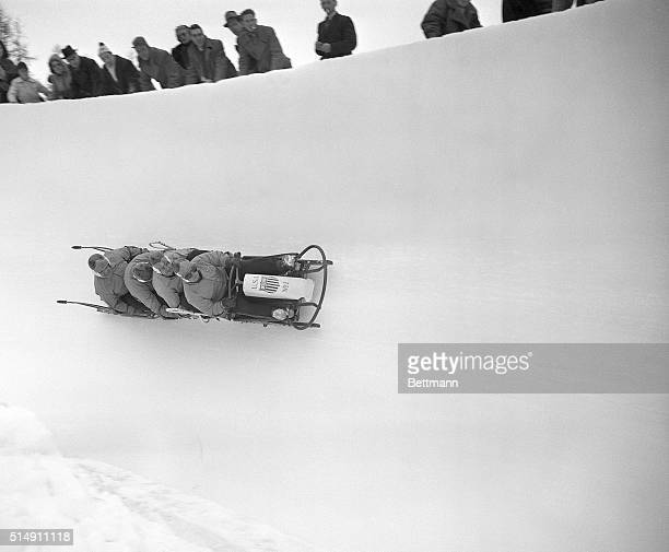 1/27/1948St Moritz Switzerland The United States first place bobsled team is shown defying gravity seeming to hang onto the air as the racing sled...