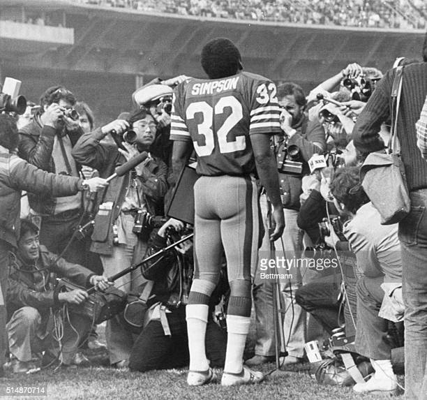 12/9/1979San Francisco CA A hoarde of photographers surround OJ Simpson as he bids farewell to San Francisco football fans at Candlestick Park prior...