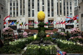 A 12foot tall Easter bunny topiary stands among white Easter lilies before the upcoming Easter holiday in Rockefeller Center on March 28 2013 in New...