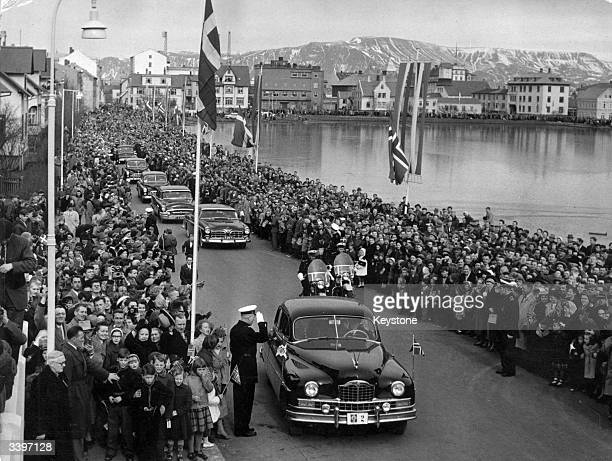 King Frederick and Queen Ingrid of Denmark drive through the streets of Reykjavik as they arrive in Iceland on an official Royal visit