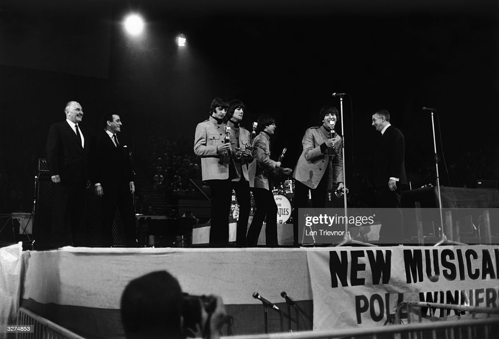 The Beatles receiving awards from Tony Bennett at the NME Poll Winners Concert at Wembley Pool
