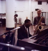 American jazz pianist and composer Thelonious Monk plays with American jazz saxophonist Gerry Mulligan in a recording studio New York City A double...