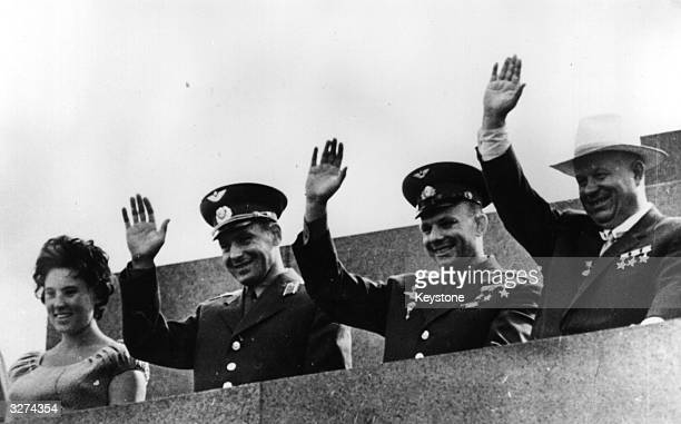 Soviet President Nikita S Khrushchev Yuri Gagarin and Major Gherman S Titov the first and second Russian cosmonauts and Titov's wife Tamara wave to...