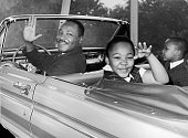 American civil rights leader Martin Luther King Jr waves with his children Yolanda and Martin Luther III from the 'Magic Skyway' ride at the Worlds...