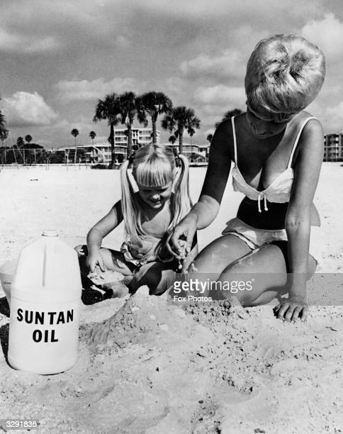 A mother and daughter make a sandcastle together on the beach at St Petersburg in Florida