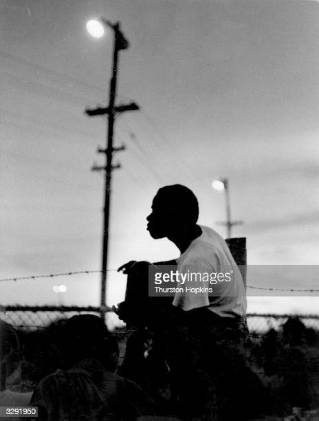 Spectators at a cycling race track on the outskirts of Kingston Jamaica Original Publication Picture Post 6832 The Royal Tour From Bermuda To Jamaica...