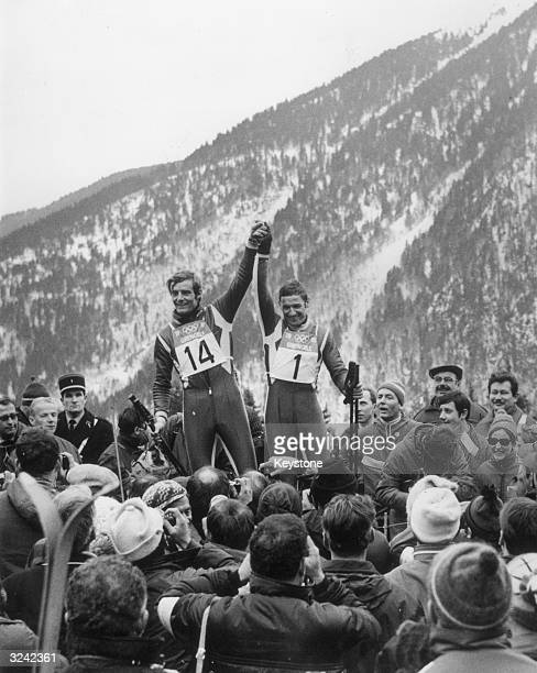 French skiers JeanClaude Killy on the left and Guy Perillat are the centre of attention during the Winter Olympics at Chamrousse after winning the...