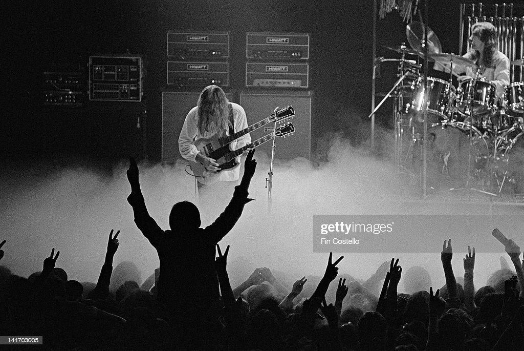 Guitarist Alex Lifeson and drummer Neil Peart from Canadian progressive rock band Rush perform live on stage at the Odeon in Birmingham England...