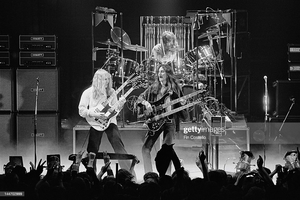 Guitarist Alex Lifeson bassist Geddy Lee and drummer Neil Peart from Canadian progressive rock band Rush perform live on stage at the Odeon in...