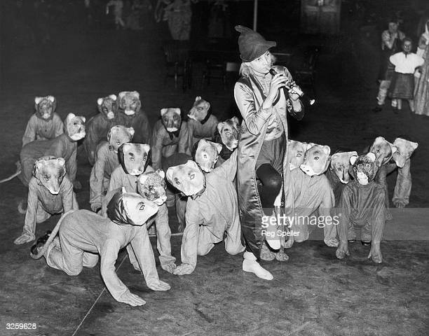 A group of boys from a Dr Barnardo's home play in a production of 'The Pied Piper of Hamelin' at the Royal Albert Hall London