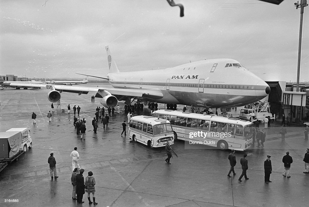 A Pan-American 747 jumbo jet on the tarmac at Heathrow Airport, where it touched down after carrying 380 people, a new world record for the number of people ever to fly in one aircraft.