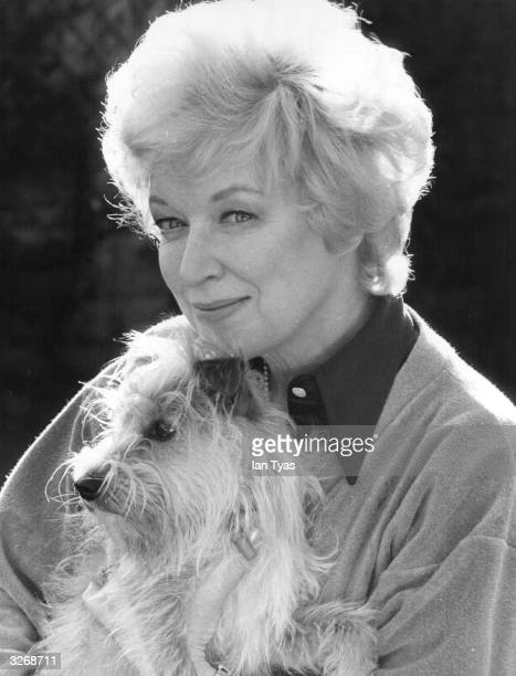 English actress June Whitfield at home in Wimbledon with her dog