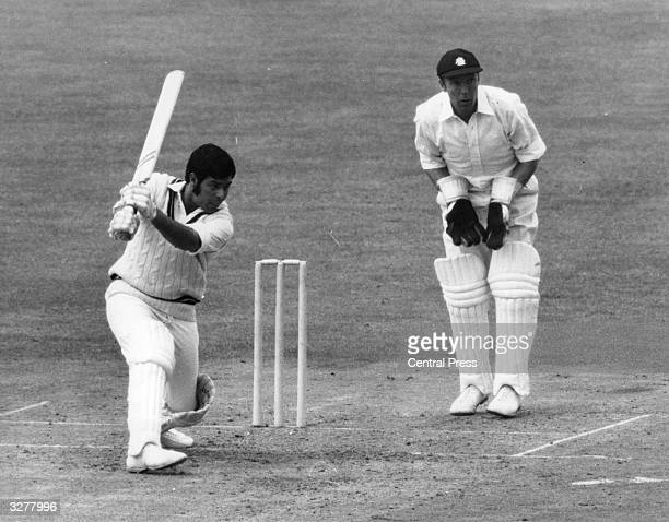Ahmed Younis hits a throw from the Middlesex bowler while the keeper John Murray looks on during the 'Gillette Cricket Cup' at the Oval London