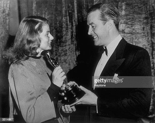 Ingrid Bergman presenting Ray Milland with the Oscar for best actor at the Academy Award ceremony in Hollywood