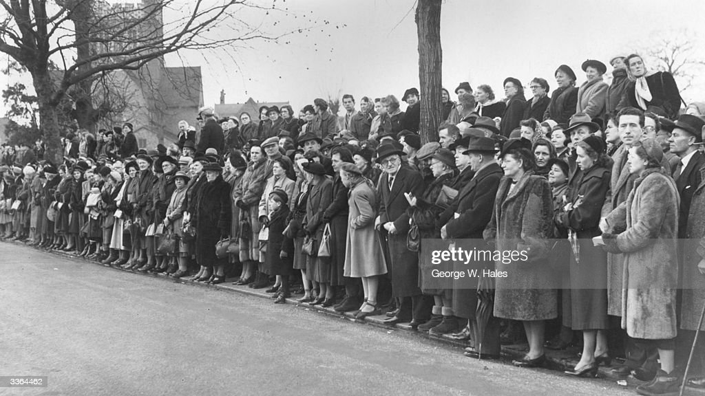 Crowds gather at the funeral of the Welsh actor composer and playwright Ivor Novello at Golders Green crematorium in London