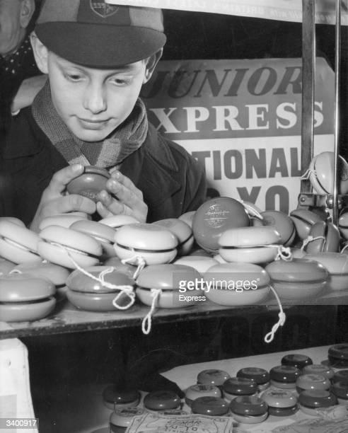 A schoolboy from a special yoyo school perusing the wares in a London yoyo shop