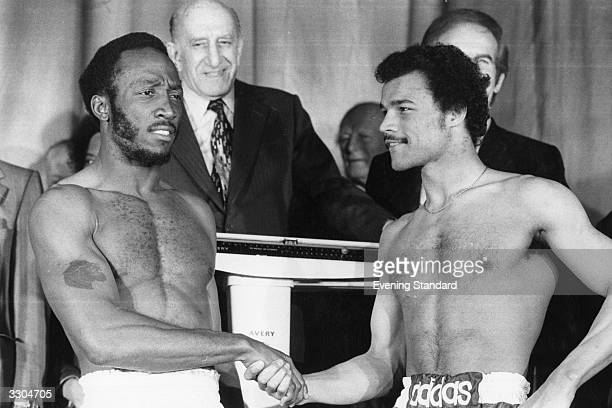 Boxer John Anthony Conteh shakes hands with opponent Lonnie Bennett at the Dominion theatre in Tottenham Court Road London