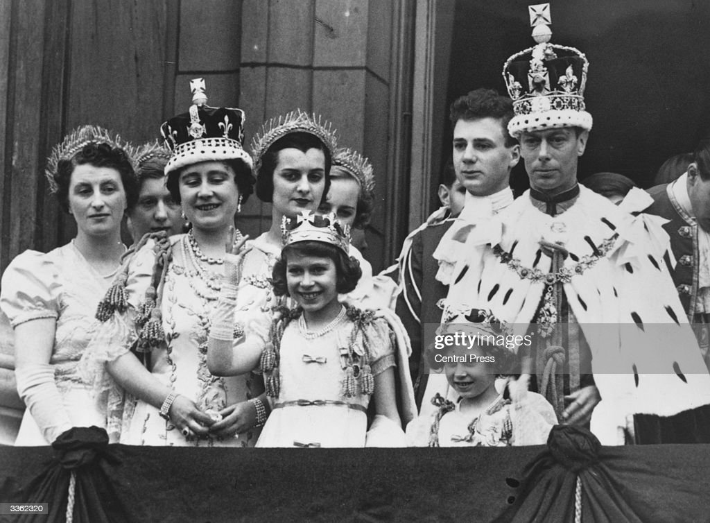 King George and Queen Elizabeth with Princesses Elizabeth (centre) and Margaret (1930 - 2002) and members of the extended Royal Family in full Coronation regalia on the balcony of Buckingham Palace after their Coronation ceremony.