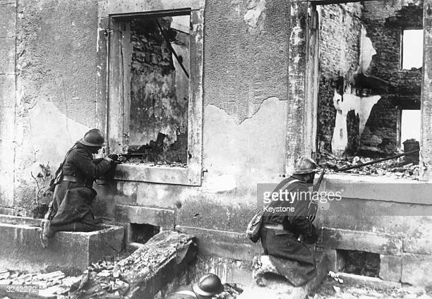 French soldiers occupy a shattered building on the front line