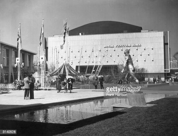 Visitors stroll outside the Royal Festival Hall on the South Bank London during the Festival of Britain